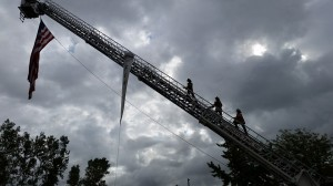 Fire Fighters raising the flag at the Defender's Dash 5k/11k